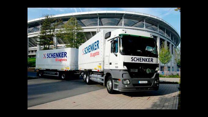 Schenker-Lkw vor Fußballstadion